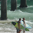 Two surfers in Huntington Beach